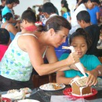 Gingerbread Houses Party, FLM volunteer and student
